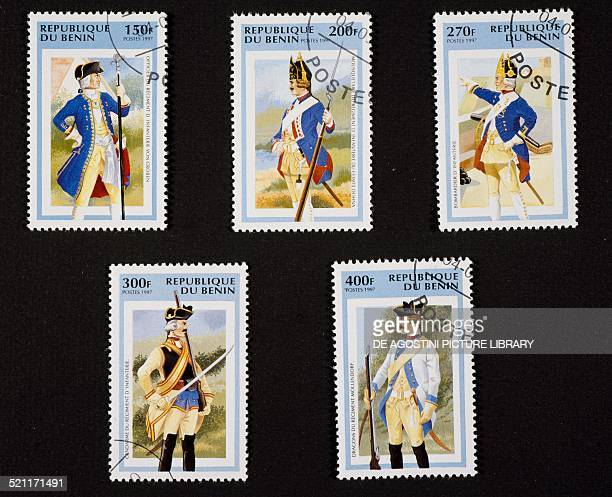 Series of postage stamps honouring Vintage military uniforms depicting top from left Officer of the Von Groben regiment infantry Musketeer of the...