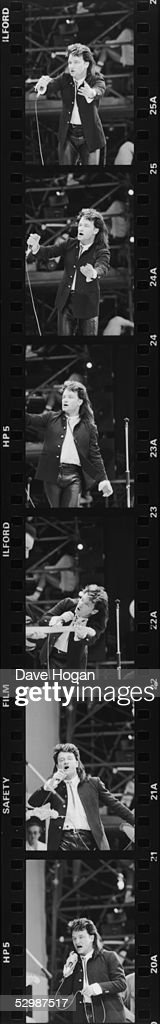 A series of six images of Irish singer Bono, during U2's performance at the Live Aid charity concert, Wembley Stadium, London, 13th July 1985.