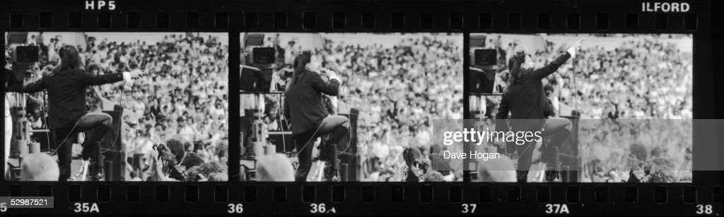 A series of three images of Irish singer Bono, during U2's performance at the Live Aid charity concert, Wembley Stadium, London, 13th July 1985.