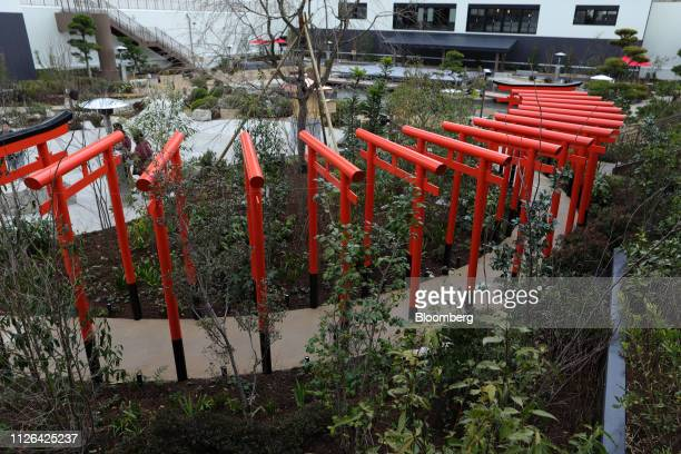 Series of torii gates stand in a rooftop garden at the Solaniwa Onsen spa at Osaka Bay Tower during a media tour in Osaka, Japan, on Thursday, Feb....