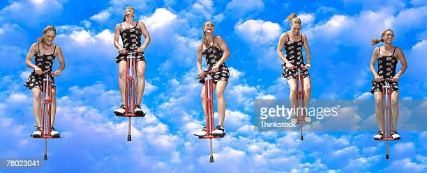 Series of woman on pogo stick in clouds