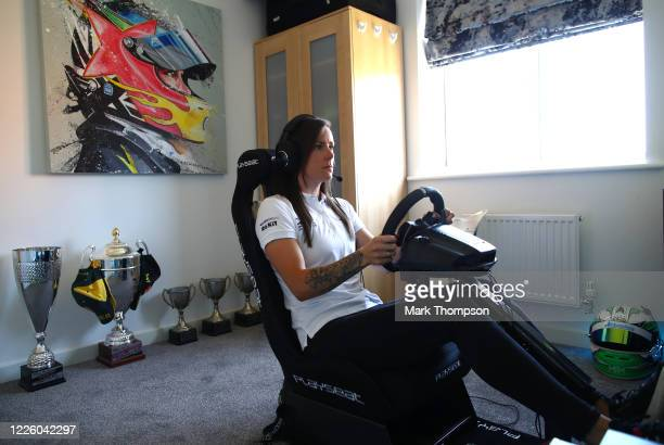 Series racing driver Abbie Eaton practices on her racing simulator during isolation at her home on May 20, 2020 in Northampton, United Kingdom. The...