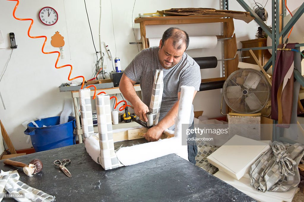 Series- Real Upholstry manufacturer working in his factory : Stock Photo