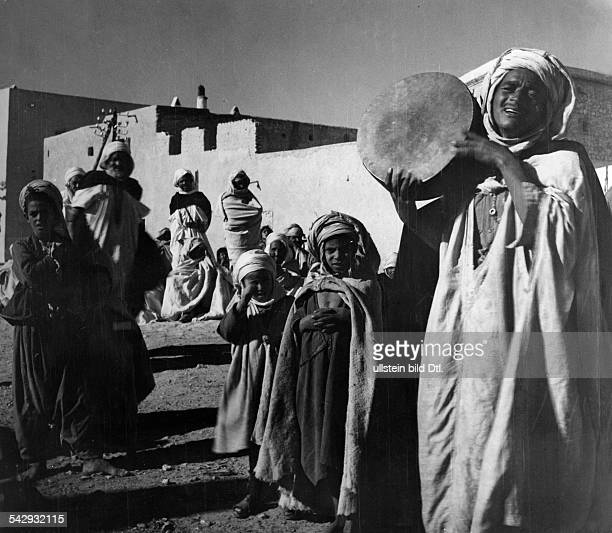 Series Reportage from Northern Africa / Tunisia 1932Arab man the storyteller Abd el Kader with tambourine Photographer Yva / Charlotte Weidler...