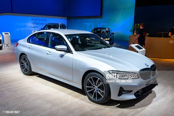Series sedan on display at Brussels Expo on January 9, 2020 in Brussels, Belgium. The current generation of BMW 3 Series cars consists of the BMW G20...