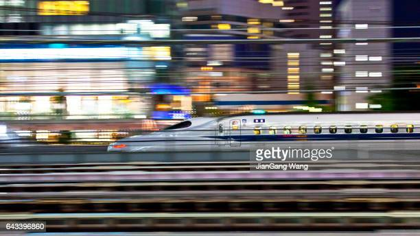 n700 series shinkansen bullet train - moving past stock photos and pictures