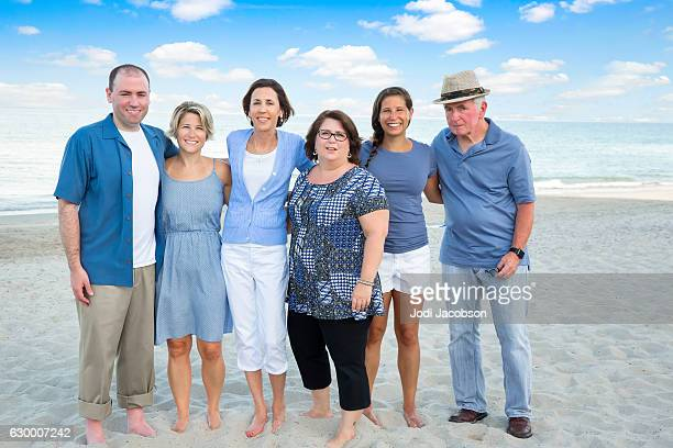 series:adults dressed in blue at beach for family reunion - fat guy on beach stock pictures, royalty-free photos & images