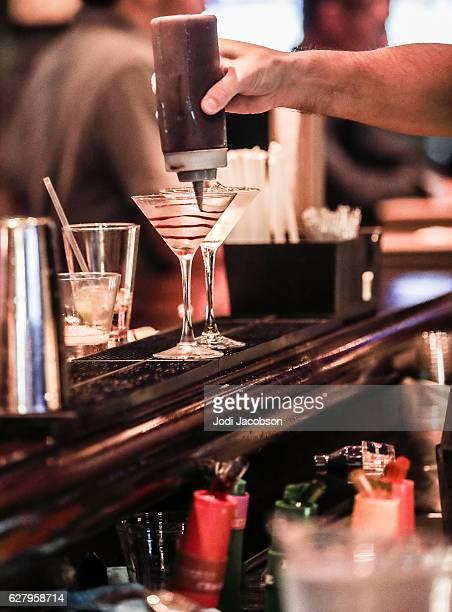 Series:Bartender preparing a chocolate martini in classic martini glass