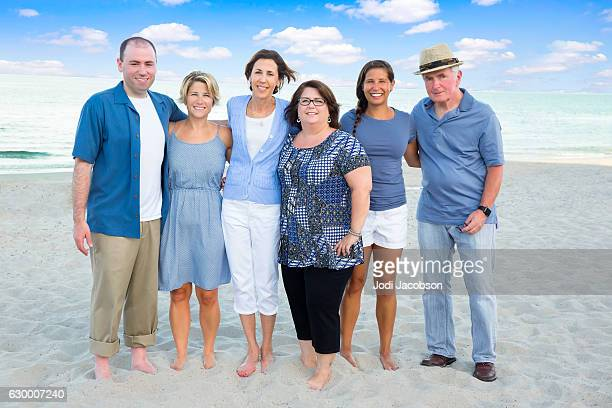 series:caucasian parents with adult children at beach for reunion - fat guy on beach stock pictures, royalty-free photos & images