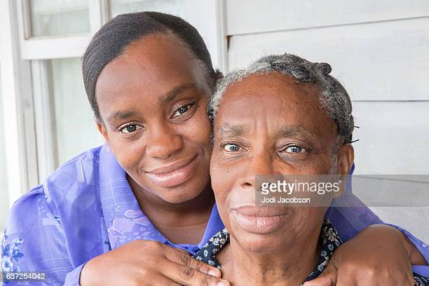 Series:Honduran woman on home porch with senior mother