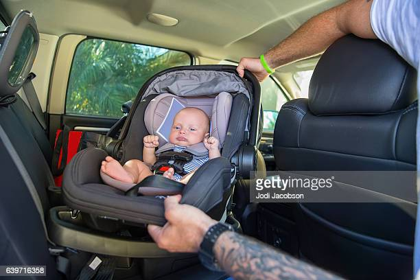 Series:Infant boy in car seat being put in car