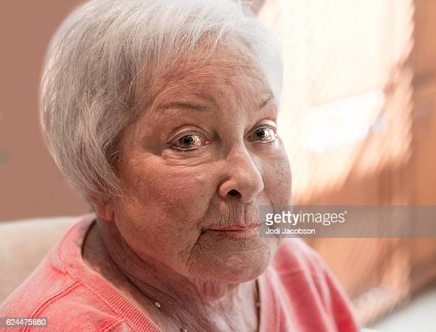 Series:Portrait of senior woman sitting with pensive expression
