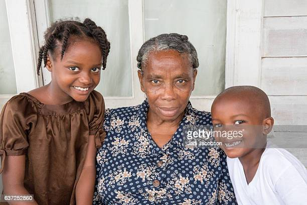 series:proud honduran grandmother with her two grandchildren - honduras stock pictures, royalty-free photos & images
