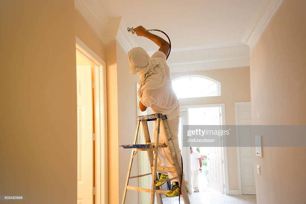 Series-Real painter spraying crown molding in a home : Stock Photo