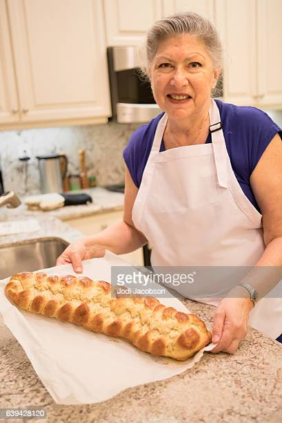 Series:Senior woman showing off her baked breaded challah