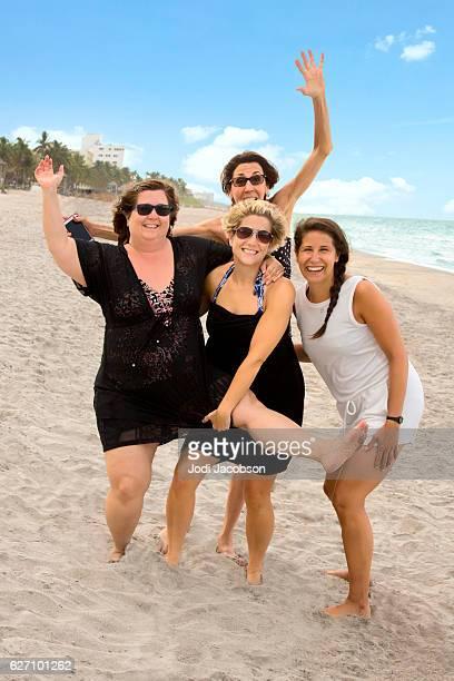 series:three women with diverse body shapes having fun at beach - dicke frauen am strand stock-fotos und bilder
