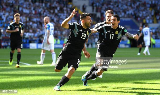 Serigo Aguero of Argentina celebrates after scoring his team's first goal with team mates Angel Di Maria and Nicolas Tagliafico during the 2018 FIFA...