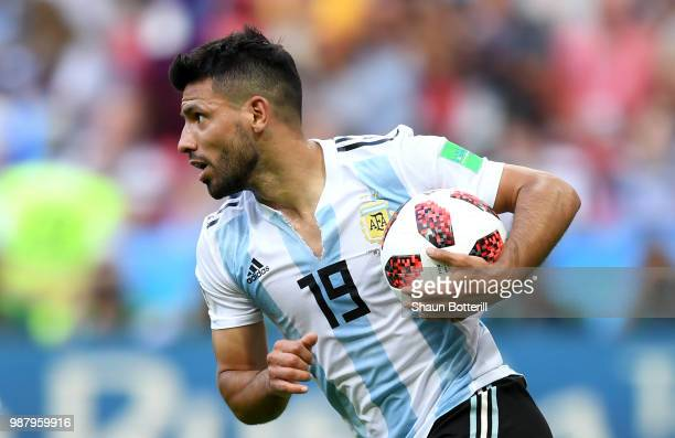 Serigo Aguero of Argentina celebrates after scoring his team's third goal during the 2018 FIFA World Cup Russia Round of 16 match between France and...