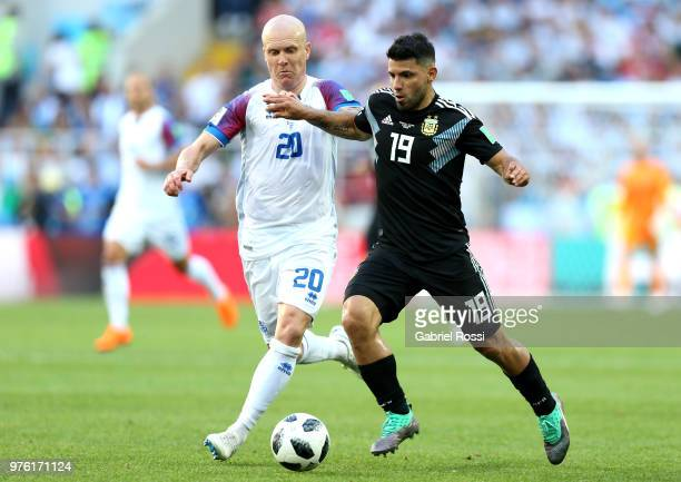 Serigo Aguero of Argentina is challenged by Emil Hallfredsson of Iceland during the 2018 FIFA World Cup Russia group D match between Argentina and...