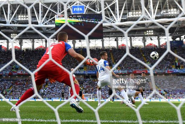 Serigo Aguero of Argentina shoots and scores his side's first goal during the 2018 FIFA World Cup Russia group D match between Argentina and Iceland...