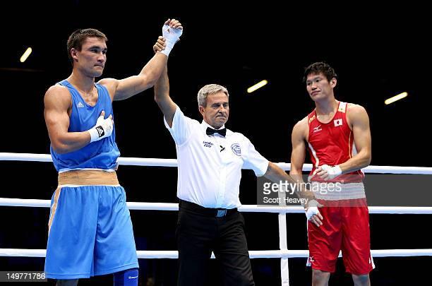 Serik Sapiyev of Kazakhstan celebrates his victory over Yasuhiro Suzuki of Japan during the Men's Welter Boxing on Day 7 of the London 2012 Olympic...