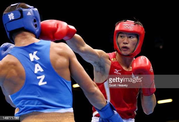 Serik Sapiyev of Kazakhstan in action with Yasuhiro Suzuki of Japan during the Men's Welter Boxing on Day 7 of the London 2012 Olympic Games at ExCeL...