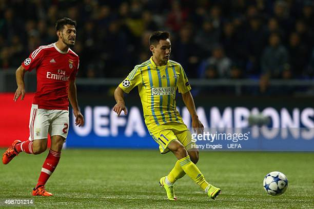 Serikzhan Muzhikov of FC Astana passes the ball during the UEFA Champions League match between FC Astana and SL Benfica at the Astana Arena on...
