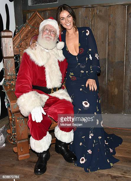 Serinda Swan and Santa at Not For Sale x Z Shoes Benefit at Estrella Sunset on December 9, 2016 in West Hollywood, California.