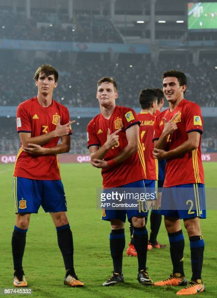 Serio Gomez of Spain with celebrates with teammates after scoring a goal against England during their final FIFA U17 World Cup match at the...