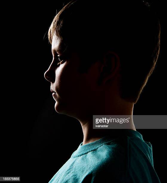 serious 10 years old boy profile - 10 11 years stock pictures, royalty-free photos & images