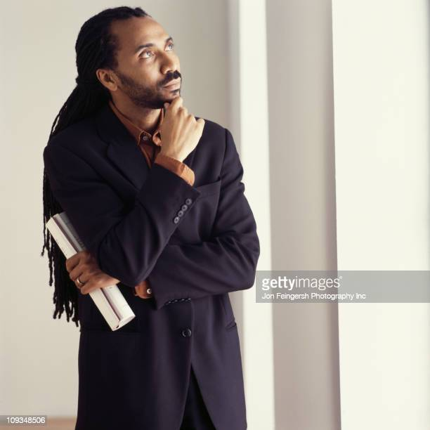 Serious African American businessman with hand on chin