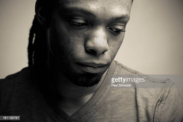 Serious African American man looking down