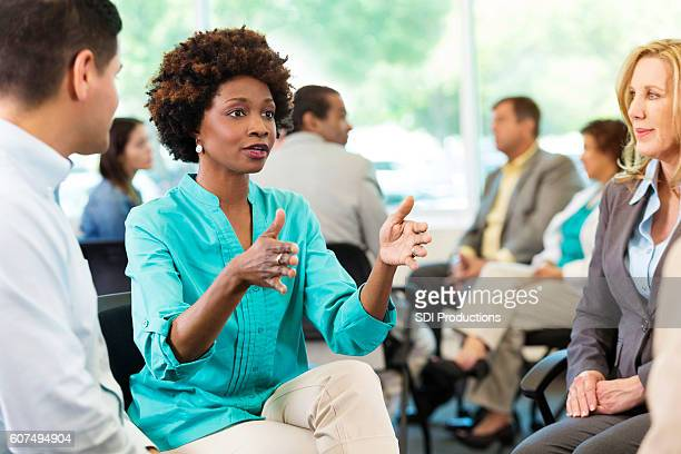 Serious African American woman makes a point during meeting