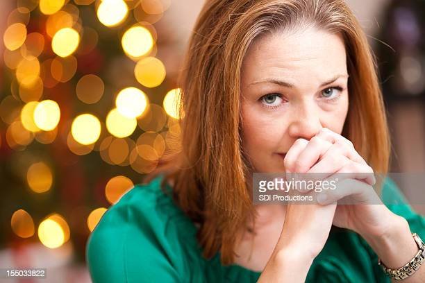 serious and concerned woman at home during holiday season - national day of prayer stock photos and pictures
