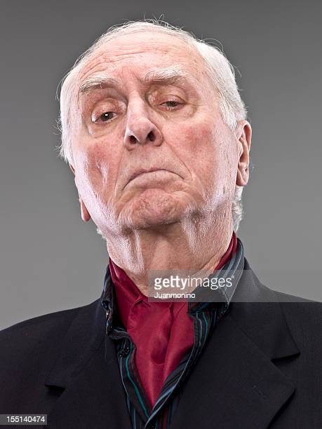serious arrogant senior man - head cocked stock pictures, royalty-free photos & images