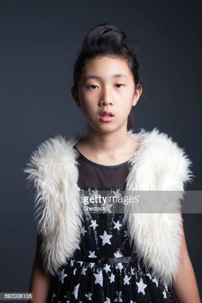 serious asian girl wearing furry vest - hairy girl stock pictures, royalty-free photos & images