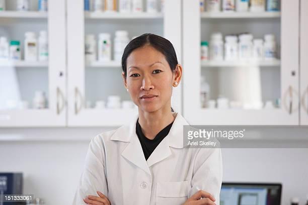 Serious Asian pharmacist