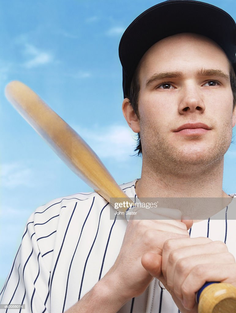 Serious Baseball Player Holding His Bat Against His Shoulder : Stock Photo