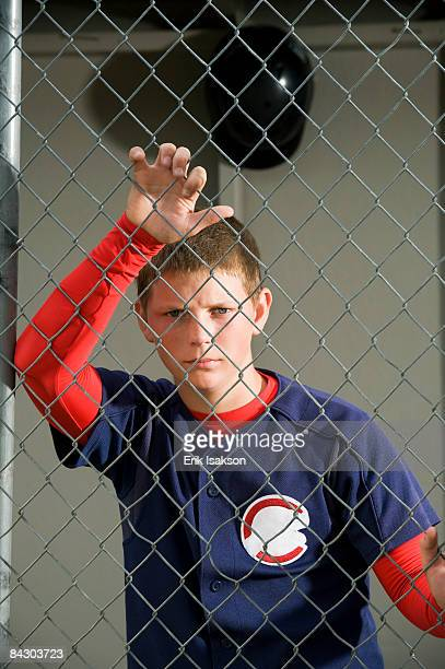 serious baseball player standing in dugout - medford oregon stock photos and pictures