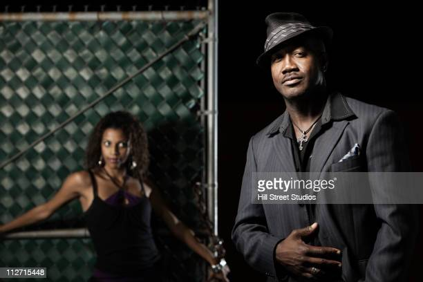 serious black man in suit standing with girlfriend - gardena california stock pictures, royalty-free photos & images