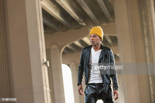 serious black man wearing yellow beanie, leather jacket - rap stock pictures, royalty-free photos & images