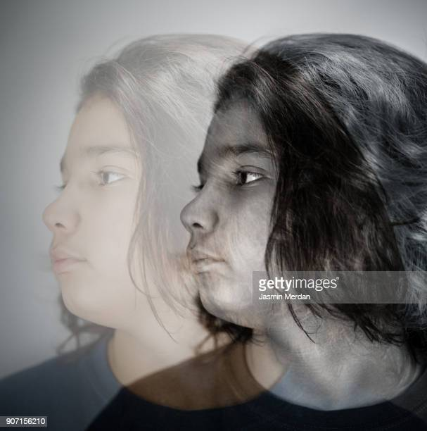 serious boy looking at camera - schizophrenia stock pictures, royalty-free photos & images