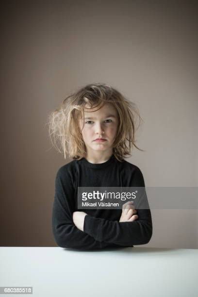 serious boy with wild hairstyle
