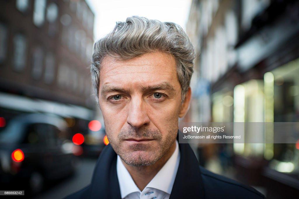 Serious Business man street portrait : Stock Photo