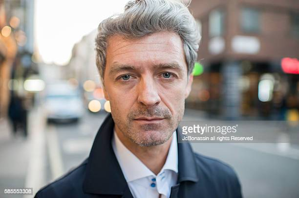 serious business man street portrait - jcbonassin stock pictures, royalty-free photos & images