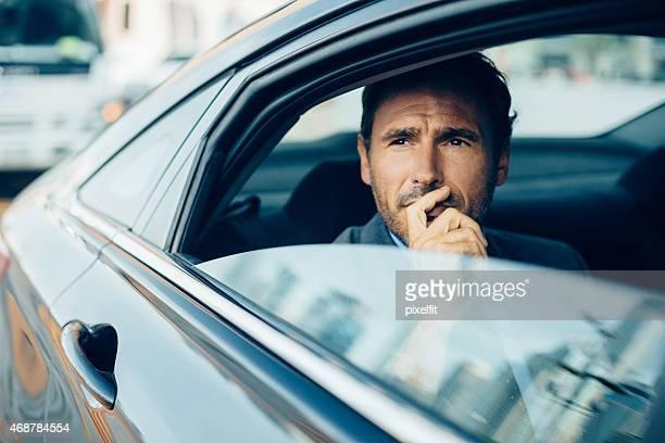 Serious businessman in a car