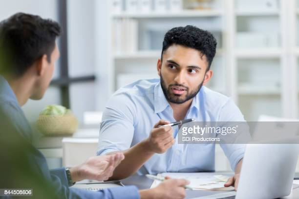 Serious businessman meets with male colleague