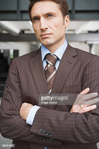 serious businessman - brown suit stock photos and pictures