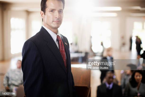 Serious businessman standing in meeting room
