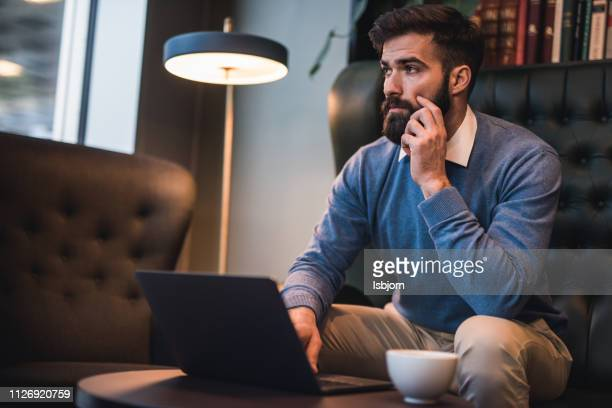 serious businessman thinking. - effort stock pictures, royalty-free photos & images